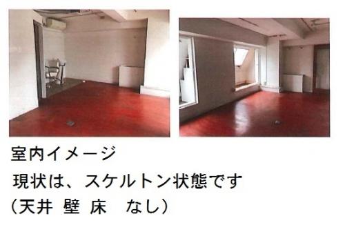白い壁と茶色のフローリングの画像
