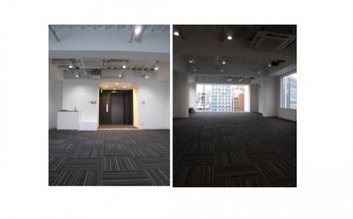 シックな絨毯と白基調の室内の画像